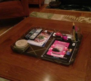 A decorative tray on my family room table keeps a few items together (remotes, coasters and crafts my daughter is working on), and inventory and cleanup manageable